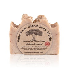 Load image into Gallery viewer, This rich, fragrant soap will soothe your skin with calming organic oatmeal. Combined with pure honey to moisturize and give you a beautiful glow. Handmade, natural, olive oil soap. Made on Vancouver Island in BC, Canada.