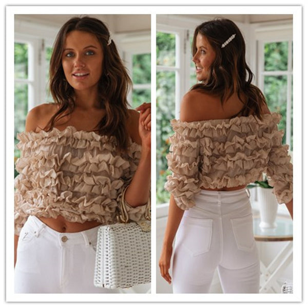 Embroidered hollow ruffled solid color one-way neck top
