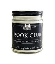 "Load image into Gallery viewer, A 9oz candle in a clear glass jar with black tin lid, called Book Club, which has notes of Cinnamon, leather, and amber indicated on a black label. Label reads ""So many books, so little time"", and includes Fly Paper Products logo."