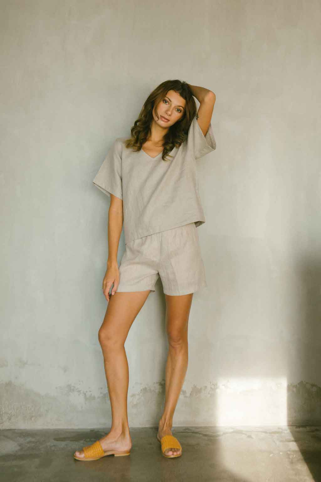 Relaxed fit linen top with a soft V neckline in natural