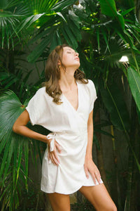 Relaxed wrap dress in soft eggshell color made from linen and rayon blend