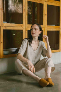 Relaxed fit linen top with a soft V neckline in natural color