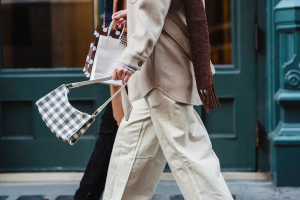 stylish ladies strolling on street after shopping