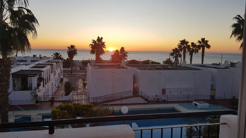 View of sunrise over the mediterranean ocean from the bedroom terrace of a beach house in Mojacar, Andalucia Spain