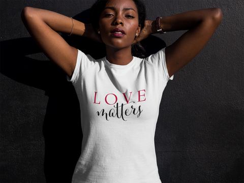 pretty black woman relaxing in a white cotton t-shirt with the Love Matters slogan print in red and black from JTEESinc