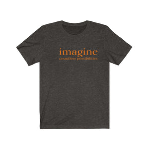 JTEESinc white unisex cotton t-shirt with bright orange print inspirational slogan imagine countless possibilities