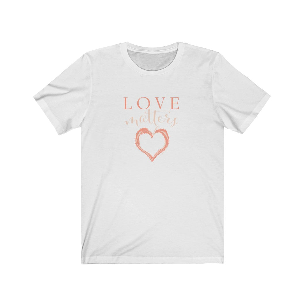 JTEESinc white unisex cotton crew neck t-shirt with peach print heart graphic and love matters slogan
