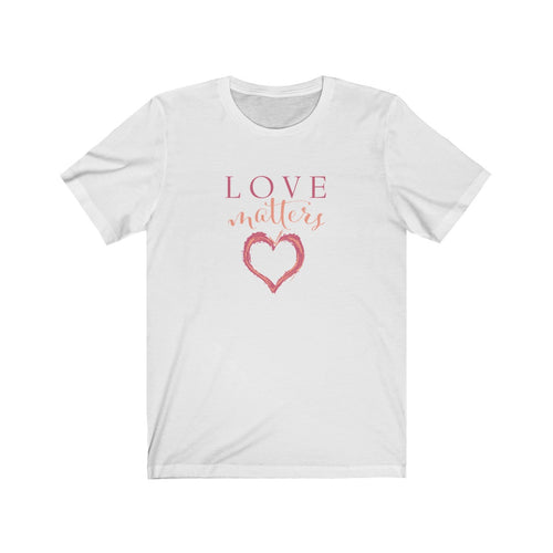 JTEESinc white unisex cotton crew neck t-shirt with pink and peach print heart graphic and love matters slogan