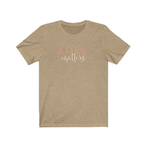 JTEESinc heather tan unisex cotton crew neck t-shirt with white print of the inspirational slogan love matters