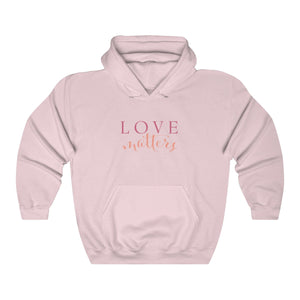 JTEESinc HipHop style soft pink hoodie with love matters slogan print in pantone fruit dove pink and peach pink