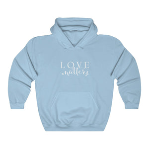 JTEESinc HipHop style light blue hoodie with love matters slogan print in white. Classic crew neck and kangaroo pockets