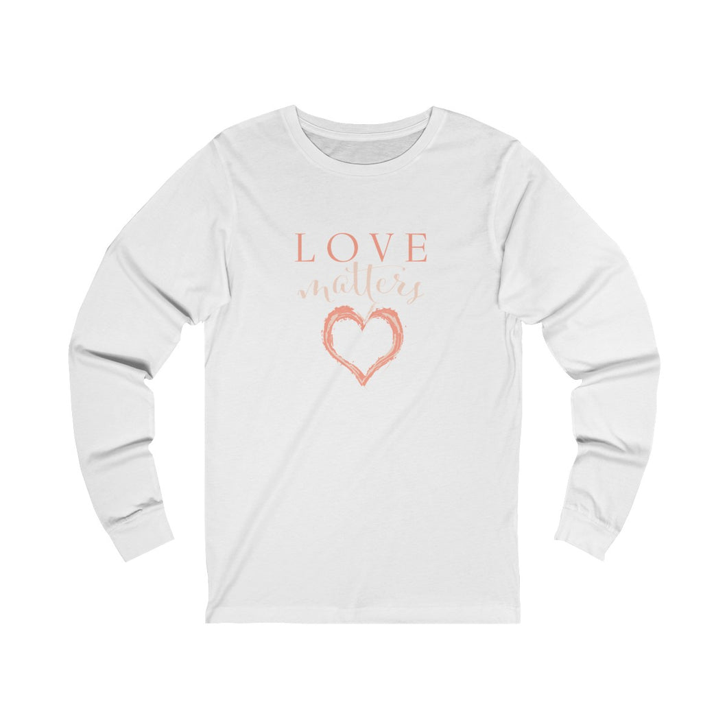 JTEESinc white unisex cotton crew neck long sleeve t-shirt with peach print heart graphic and love matters slogan