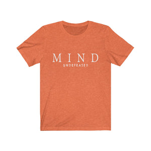 JTEESinc heather orange unisex cotton crew neck t-shirt with white print design featuring the slogan mind undefeated