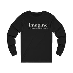 JTEESinc black unisex cotton long sleeve t-shirt with white print inspirational slogan imagine countless possibilities