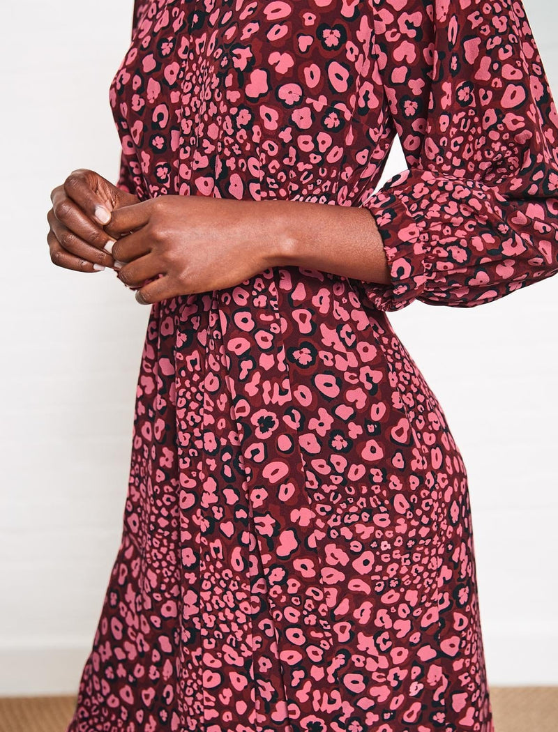Our bestselling Lauren dress now comes in our head-turning, leopard-pansy print in a new Rose colourway. Made from 100 per cent silk, with its raglan sleeves and delicately gathered high neck, it classically elegant and makes the perfect date dress with strappy heels or open-toe sandals. Alternatively, pair it with a black tailored Cefinn jacket and ankle boots or court shoes when you want to make a bold style statement at a work meeting.