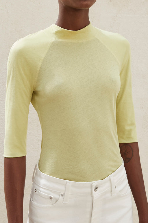Nanushka Madi Raglan Turtleneck Top in Lime.