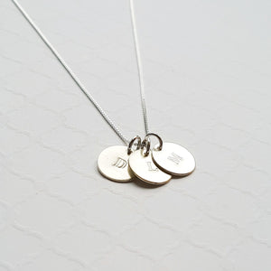 custom sterling silver necklace with tiny stamped initial discs