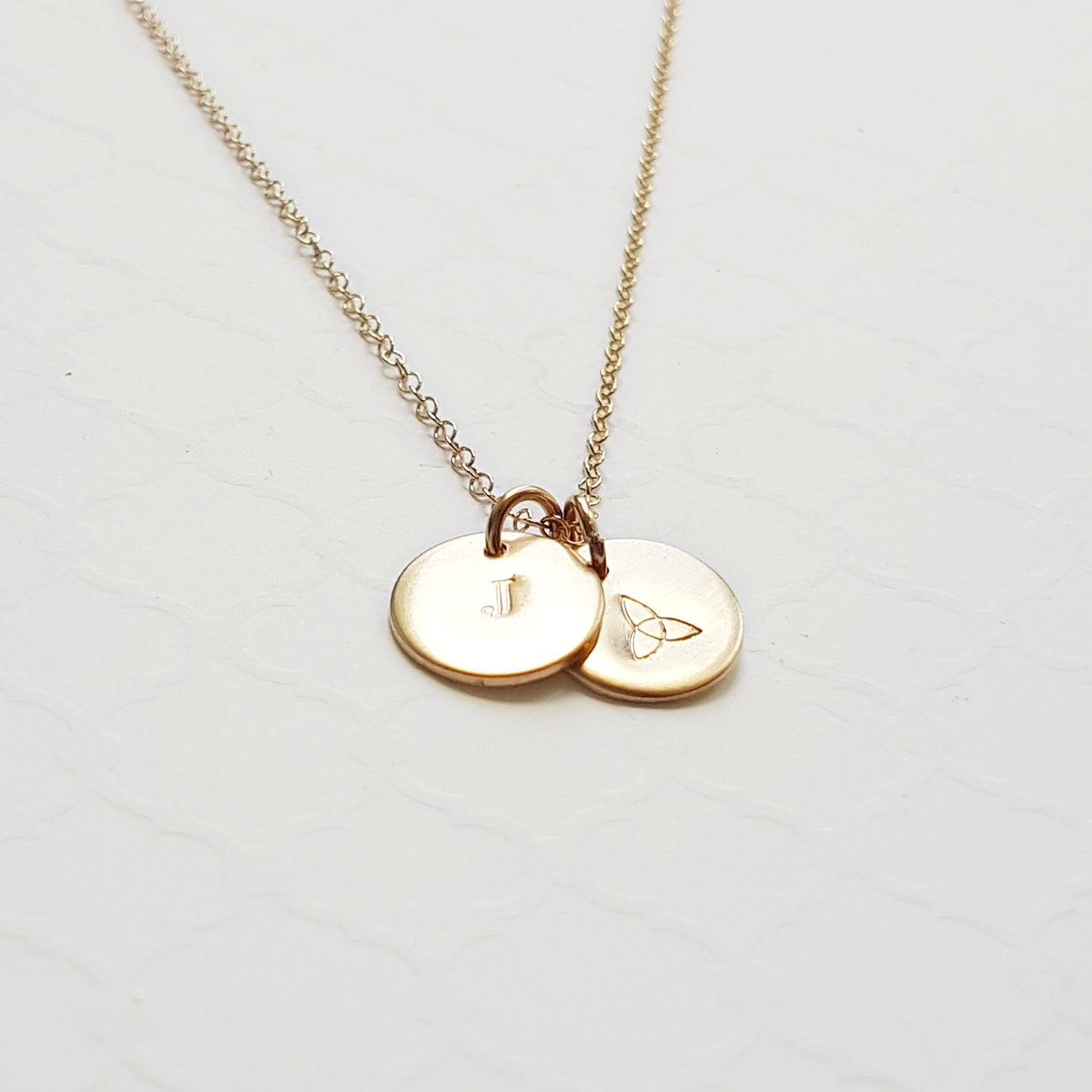 custom yellow gold necklace with tiny stamped initial discs