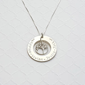 sterling silver family washer necklace with tree charm in the center