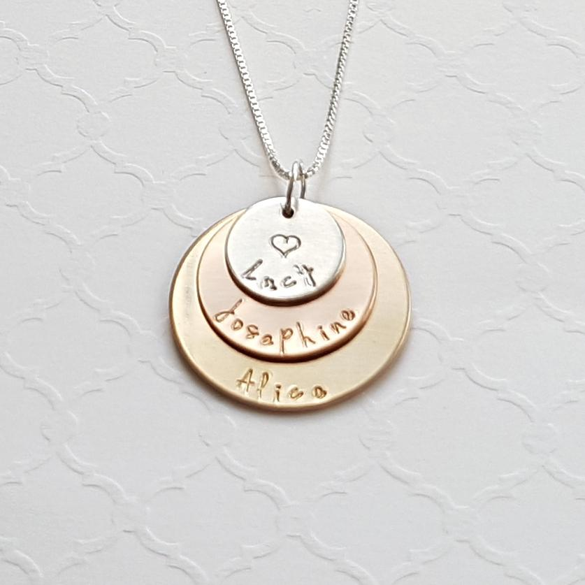 three-layer mixed metal necklace with sterling silver, rose gold, and yellow gold discs