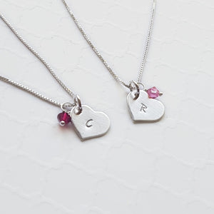 two sterling silver heart initial necklaces with birthstones