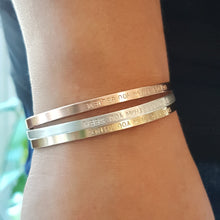 Load image into Gallery viewer, stack of cuff bracelets in sterling silver, rose gold and yellow gold on a woman's wrist