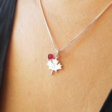 Load image into Gallery viewer, woman wearing sterling silver maple leaf initial necklace with swarovski birthstone