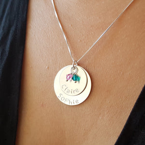 woman wearing two-layer sterling silver disc necklace with birthstones