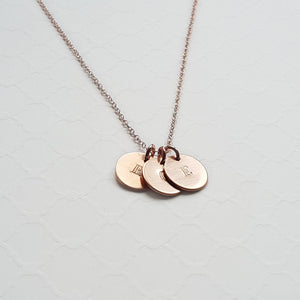 custom rose gold necklace with tiny stamped initial discs