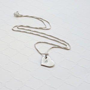 custom tiny heart initial necklace in sterling silver