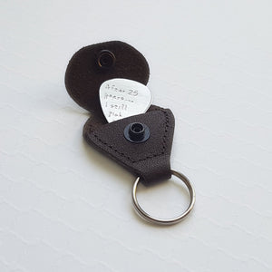 sterling silver guitar pick with brown leather keychain case