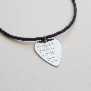 sterling silver guitar pick necklace on a brown leather cord