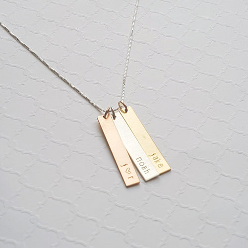mixed metal necklace with long bars in sterling silver, rose gold, and yellow gold