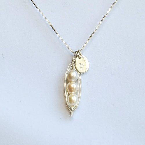 Wire-wrapped silver pea pod necklace