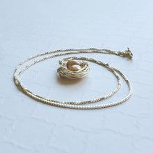 Load image into Gallery viewer, Wire-wrapped sterling silver bird's nest necklace with freshwater pearl eggs