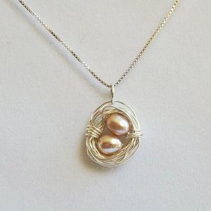 Wire-wrapped sterling silver bird's nest necklace with freshwater pearl eggs