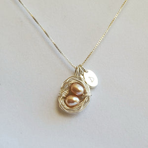 Wire-wrapped sterling silver bird's nest necklace with freshwater pearl eggs and initial charms