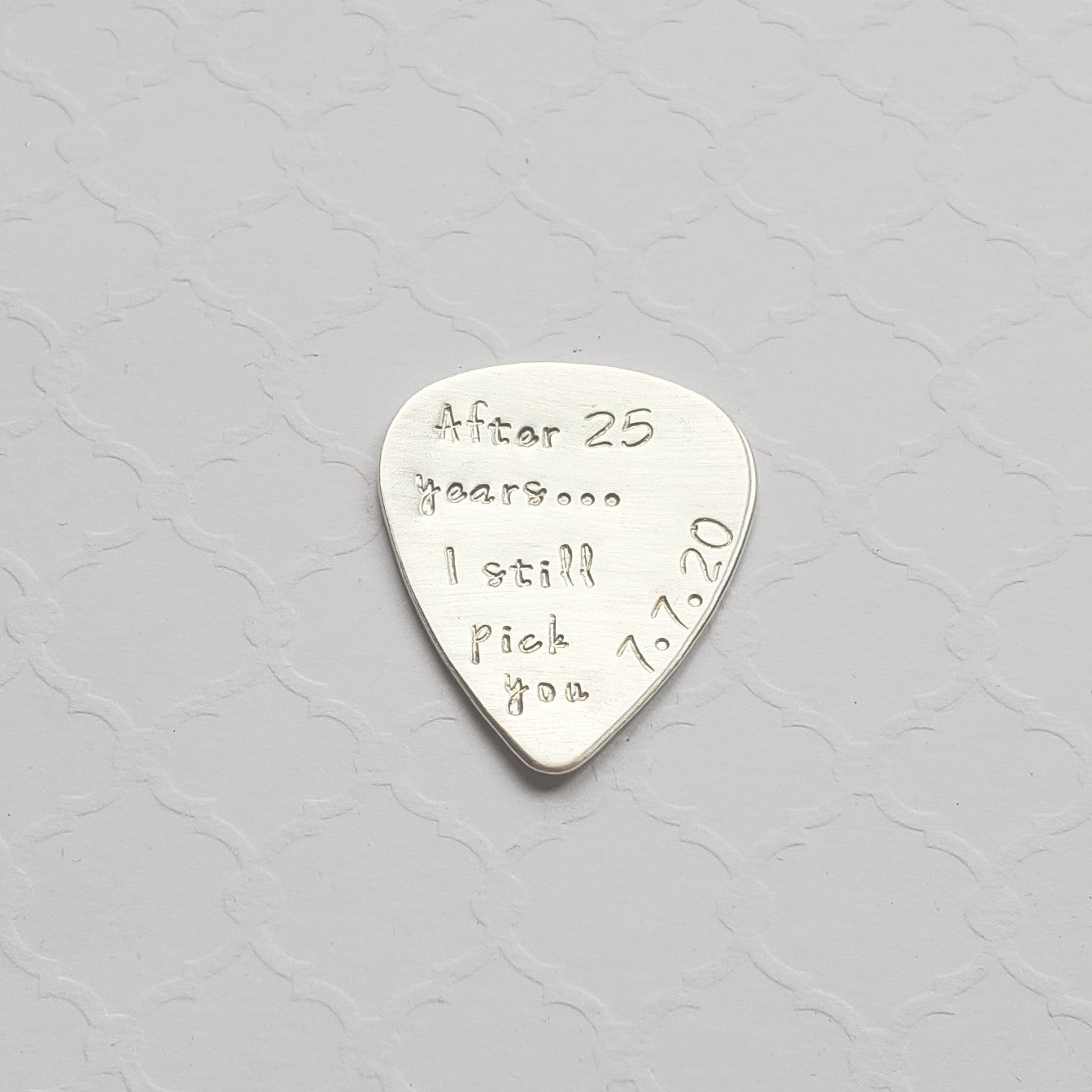 25th anniversary sterling silver guitar pick