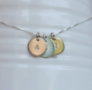 custom necklace with tiny stamped initial discs in sterling silver, rose and yellow gold