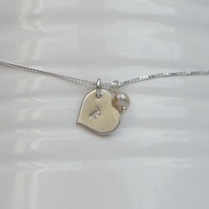 custom tiny heart initial necklace in sterling silver with freshwater pearl