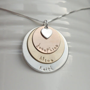 sterling silver, yellow and rose gold three-layer mixed metal mom necklace with kids' names and heart charm