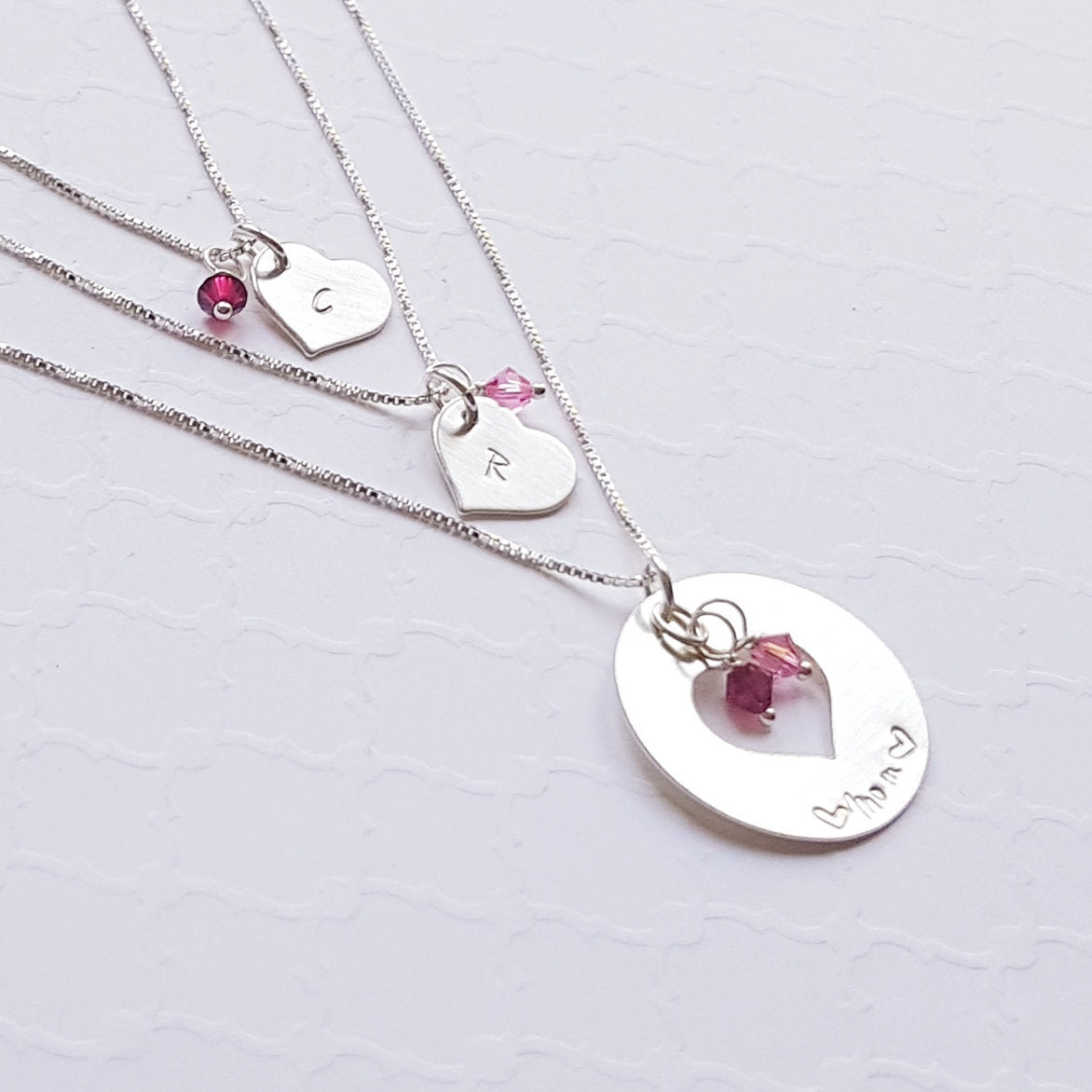 Sterling silver washer necklace and two small heart necklaces with birthstones