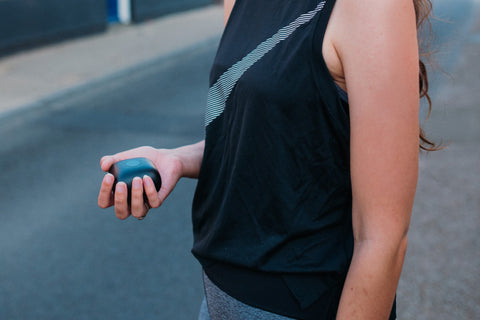 Woman holding ProSport wireless charging case in her hand