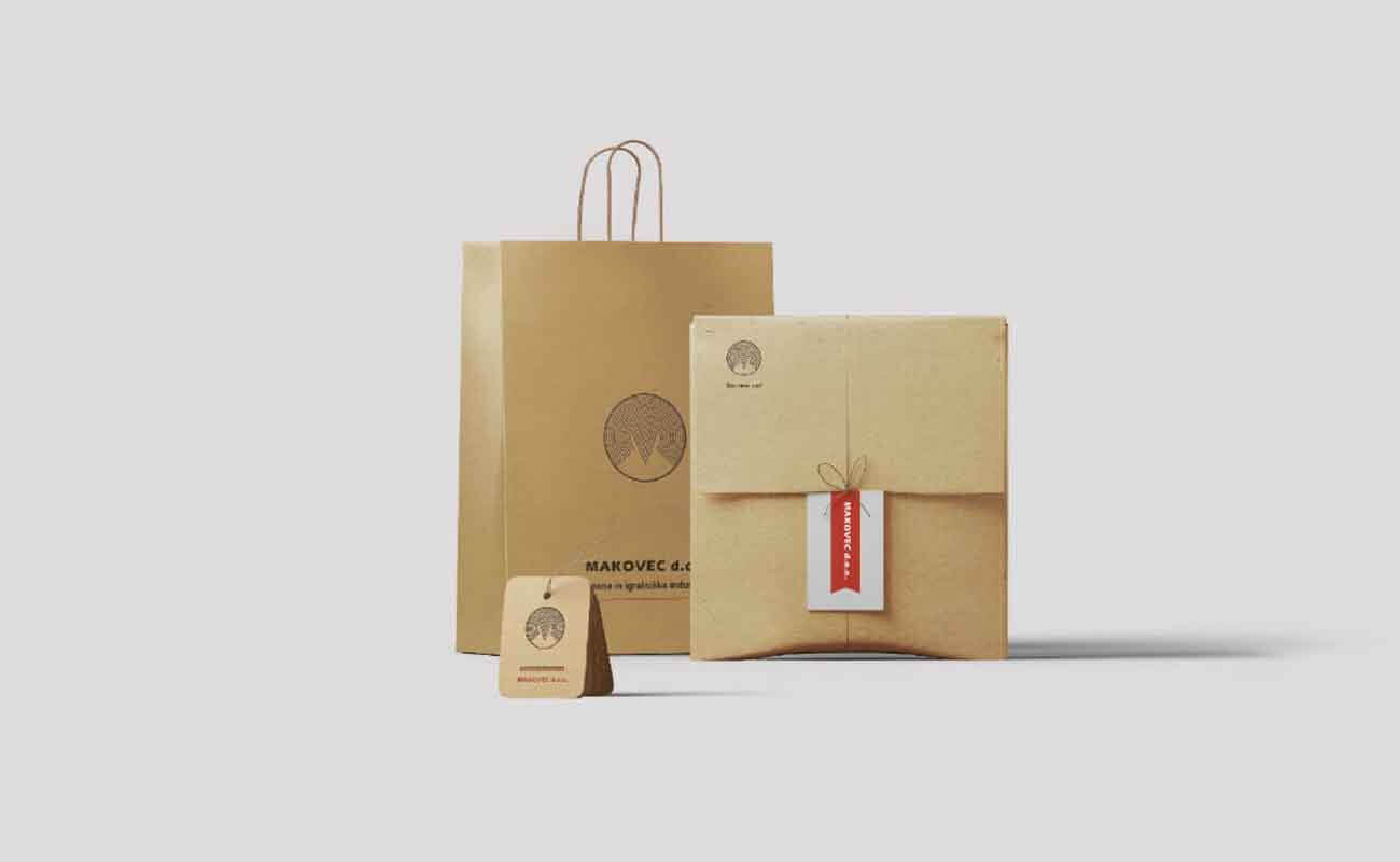 Graphic design applied on three different products: paper bag, envelope, tag