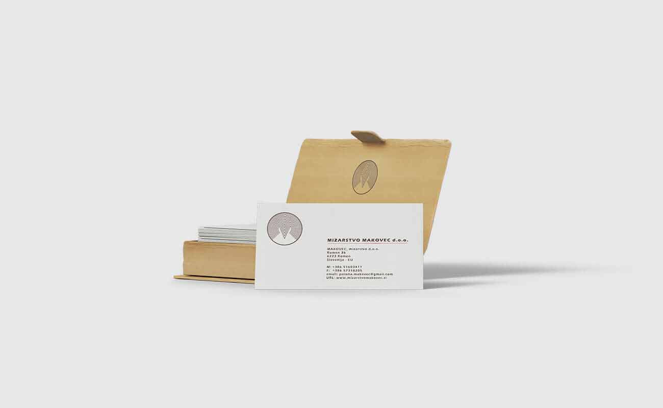 a box with business cards with specific graphic design applied for Mizarstvo Makovec d.o.o brand