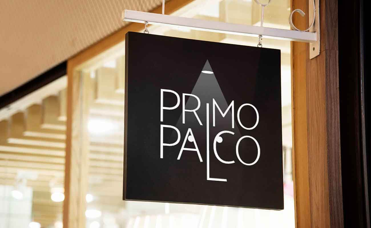 Primo Palco logo on a board hanging from the door