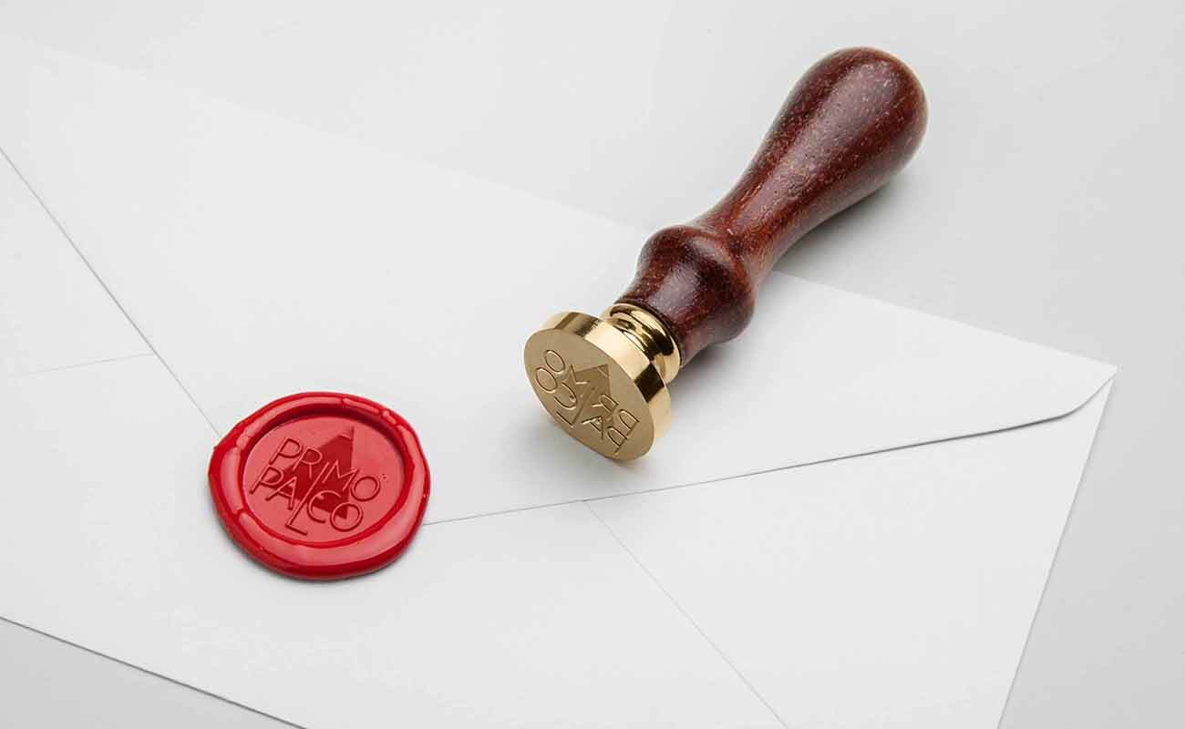 Primo Palco logo on a seal above an envelope