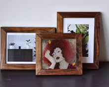 Load image into Gallery viewer, Three small wooden frames. Io one of them is an illustrated female portrait by Darka White. In two others are photos of some plants.