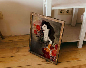 A framed illustrated artwork of a female portrait by Darka White. Old wooden frame leaning on some shelves.