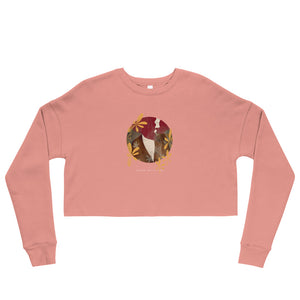 "A pink crop sweatshirt with a print. The print is a circled illustration of a woman's portrait. A sign says: ""Darka White Art"""